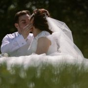 shot of couple in a field Beeston Manor Wedding.